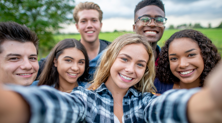 Group of young people taking selfie