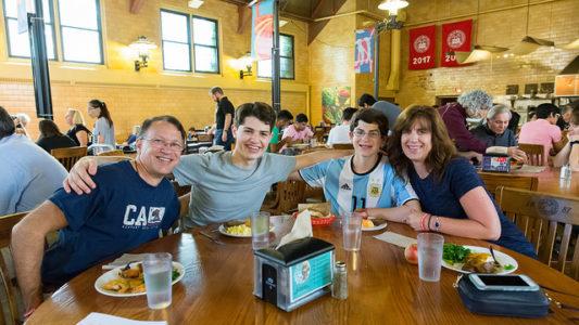 Family smiling at tab