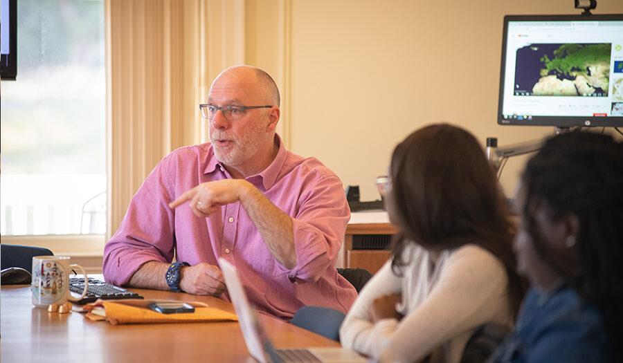 Ken MacLean talking to students