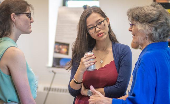Professors talking at Hiatt event