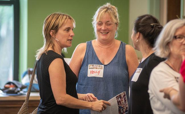 Teachers talking at Hiatt event