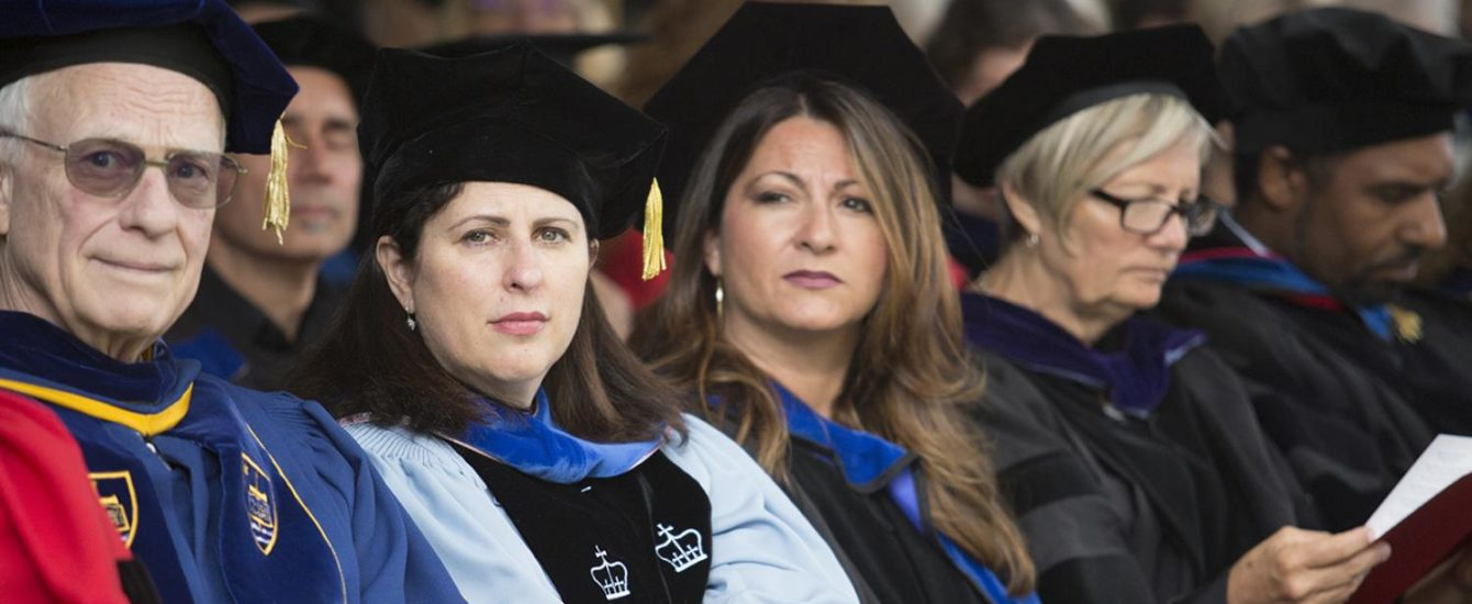 faculty members sitting in commenceme