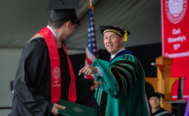 President Fithian smiling at graduate student