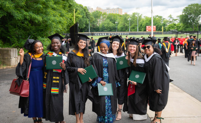 Group of students posing with their diplomas