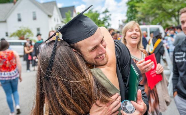 Graduate student hugging family/friend