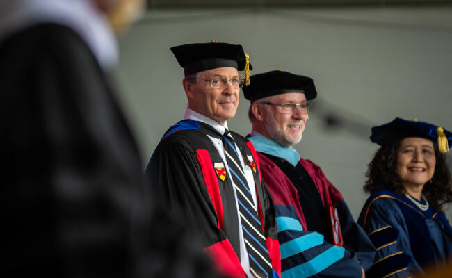 Faculty and staff on stage of commencement ceremony