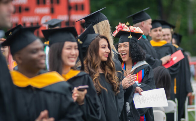 Group of graduate students smiling