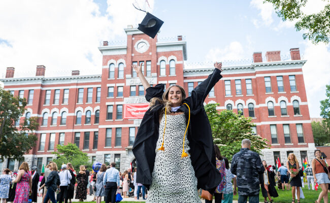 Student throwing graduation cap in the air