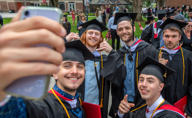 Group of students taking selfie at Commencement
