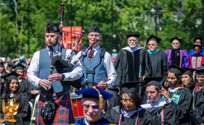 Men playing bagpipes on Granger Field
