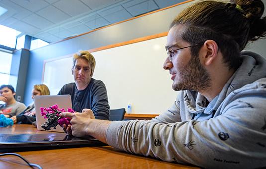 Student showing virus model