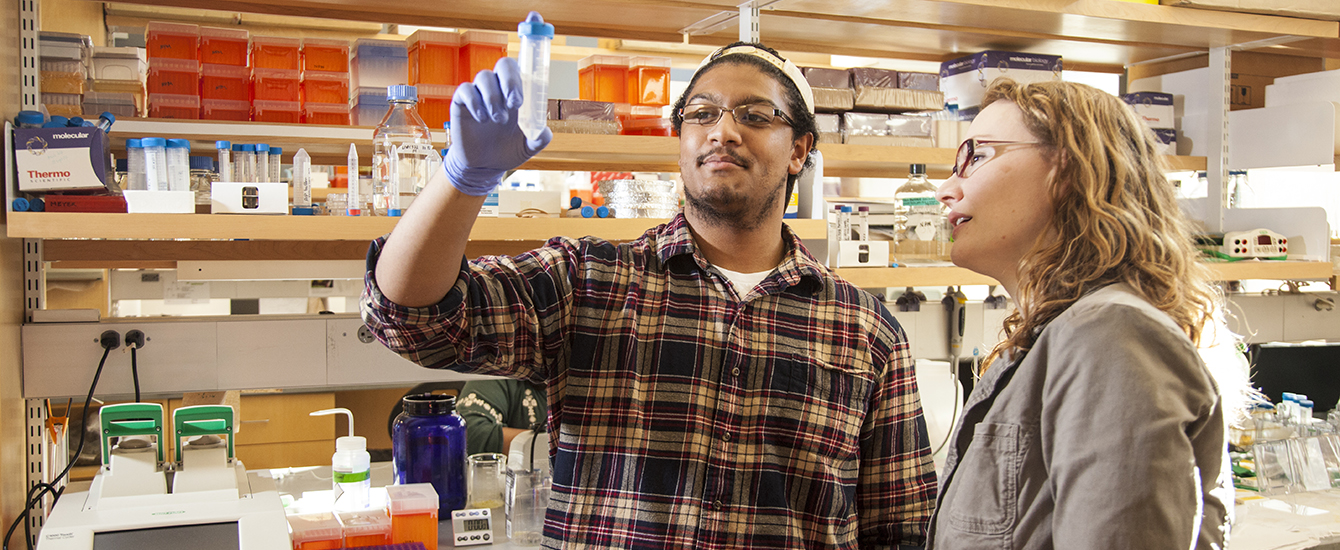 Student and professor in laboratory