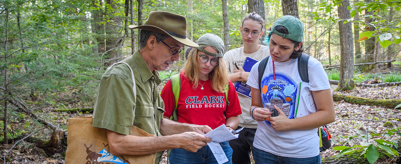 Students and professor in woods for conservation class