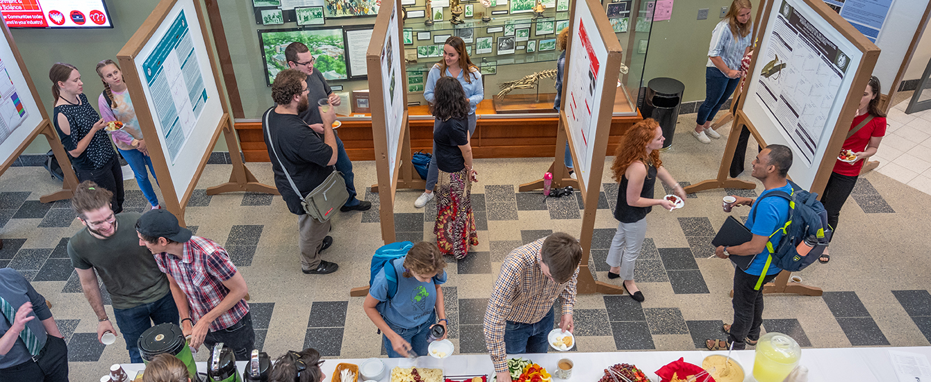 Graduate students at research poster session