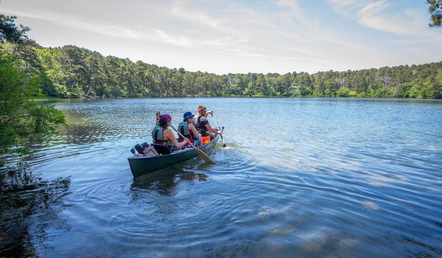 People in canoe in Cape Cod kettle pond