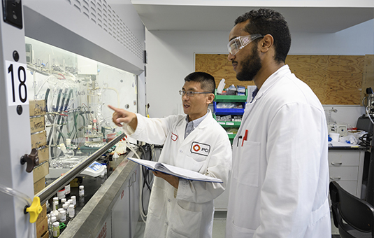 student intern with manager of lab going over equipment