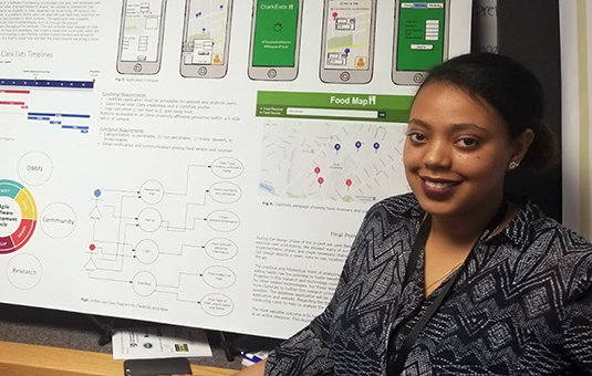 Computer science student at reserach poster