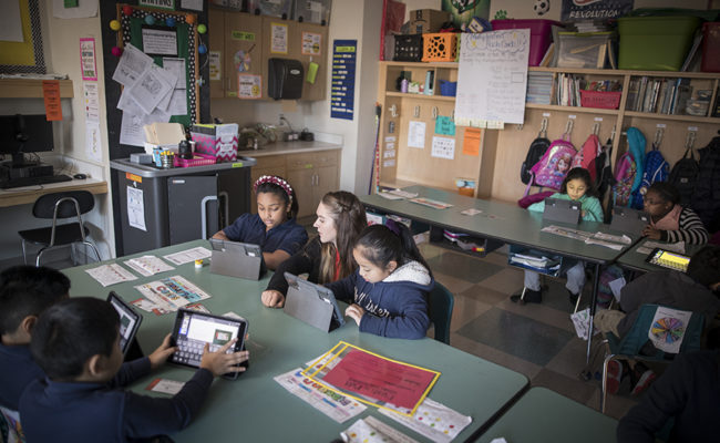 Student teacher in classroom at Claremont Elementary