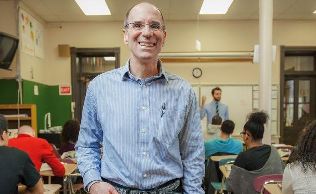 Tom Del Prete in classroom at high school