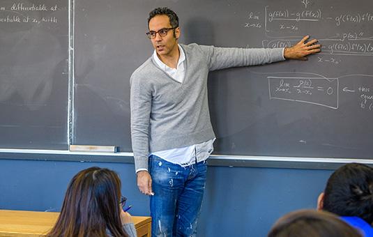 a math teacher showing an equation