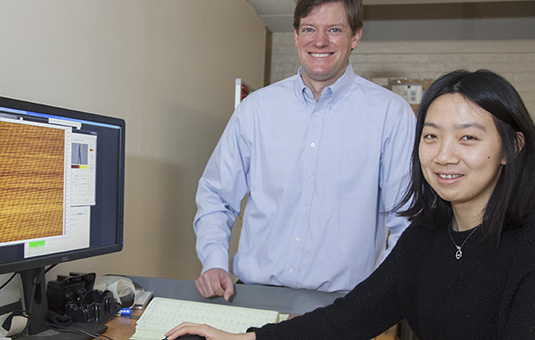 Michael Boyer with graduate student at computer