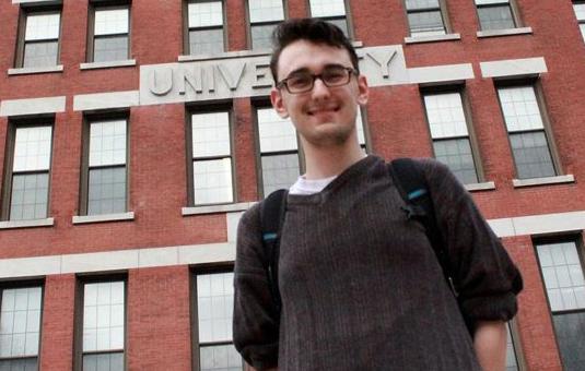 sociology major student standing in front of jonas clark building