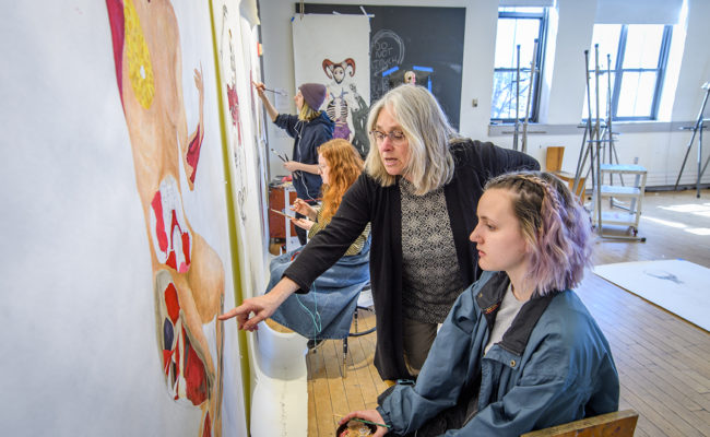 Studio Art Professor Elli Crocker discusses a student's self-portrait.