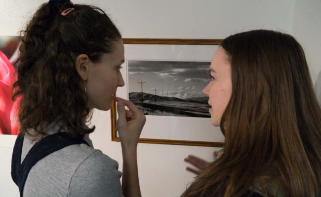 two girls looking at worcester art