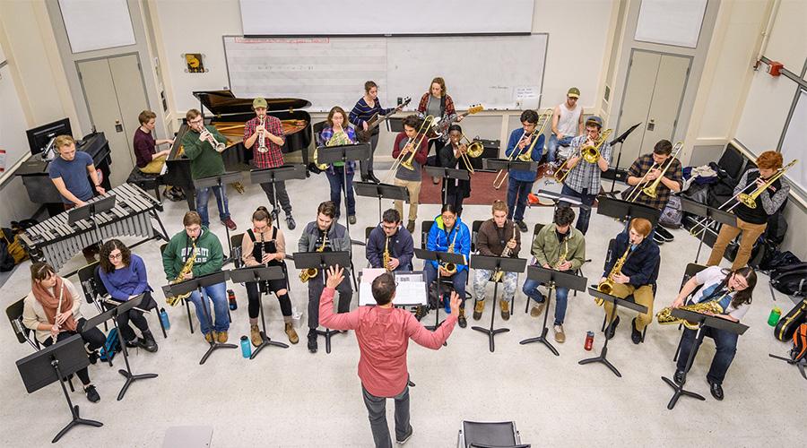 music professor conducting students