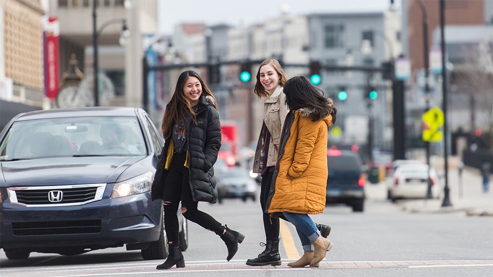 girls walking across street