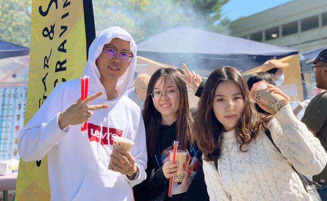 chinese students at street food festival