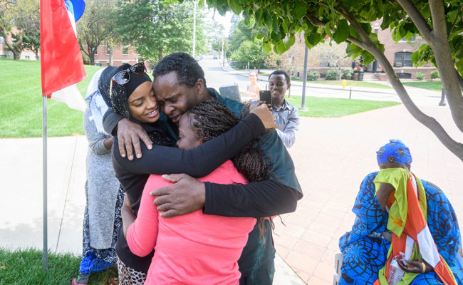 international parents hugging student on move in day