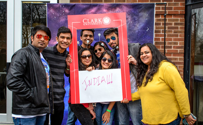 international students posing in photobomb frame