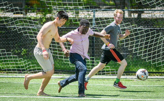 international students playing soccer