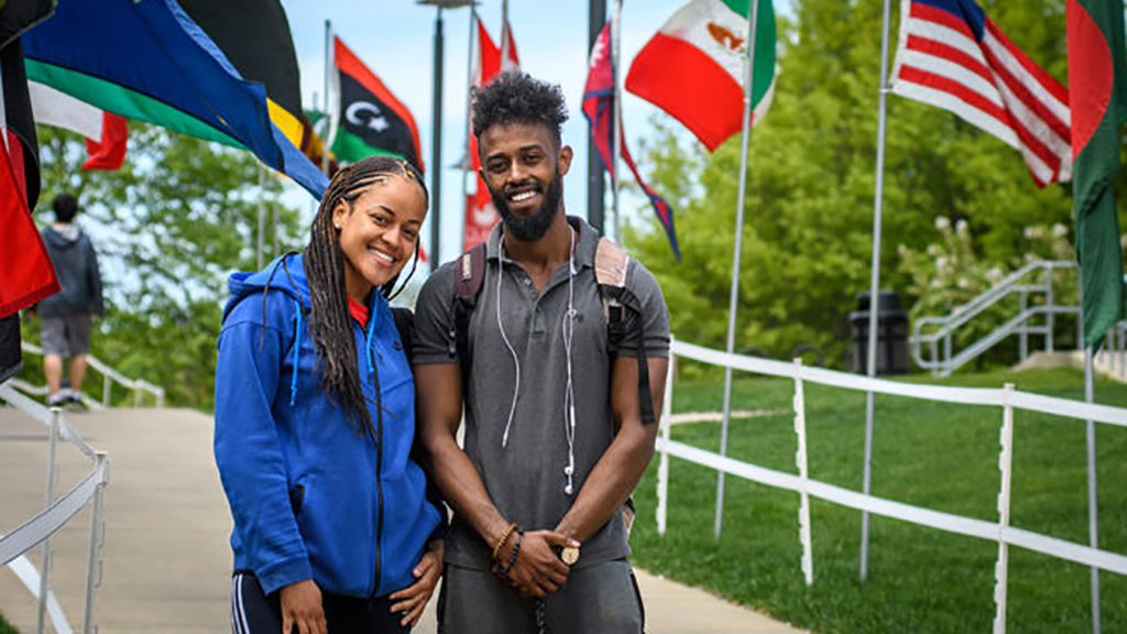 Students in front of world flags