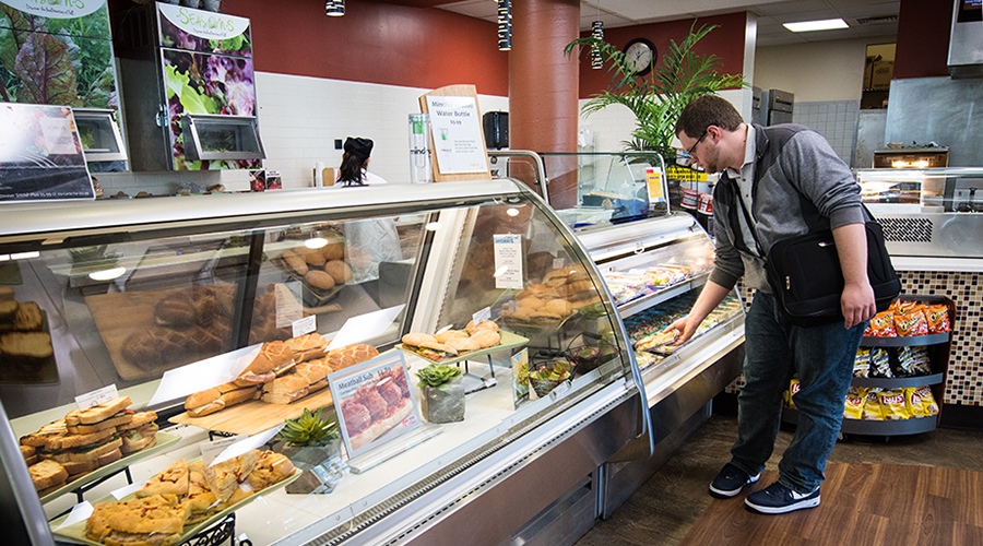 student picking food in cafeteria