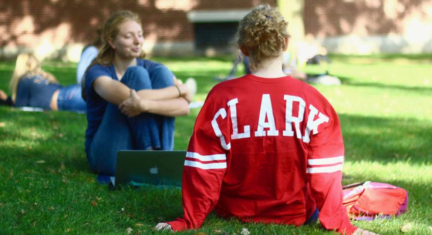 Girl with clarkie sweetshirt on