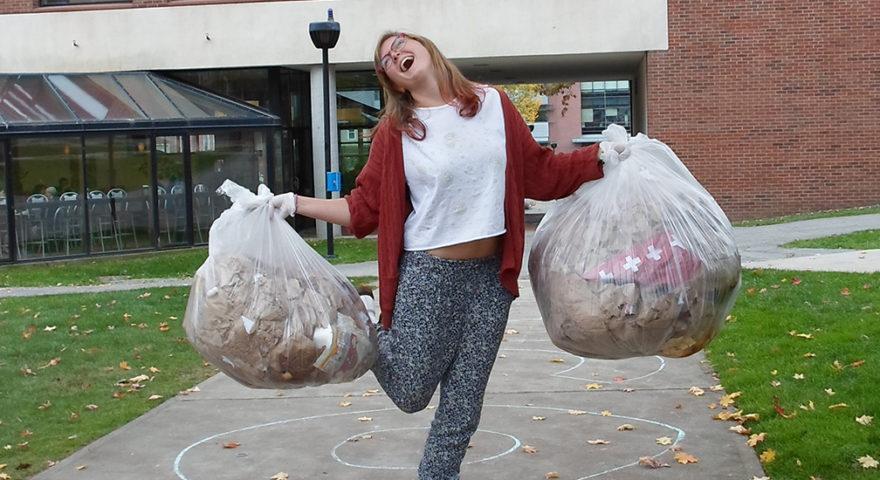 girl dancing with trash