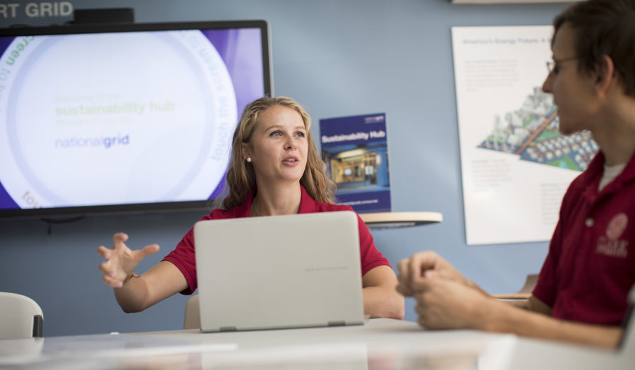woman talking to male while looking at compute