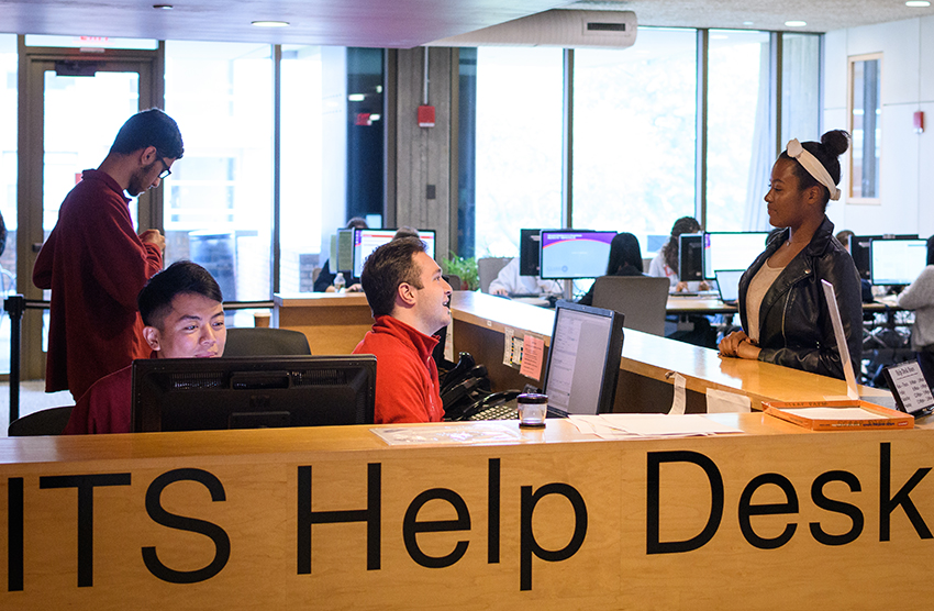Students working at ITS help desk