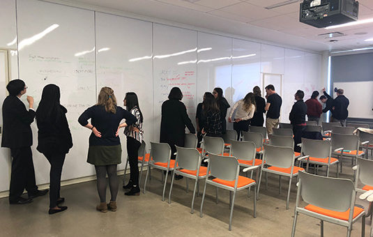 students looking at whieboard