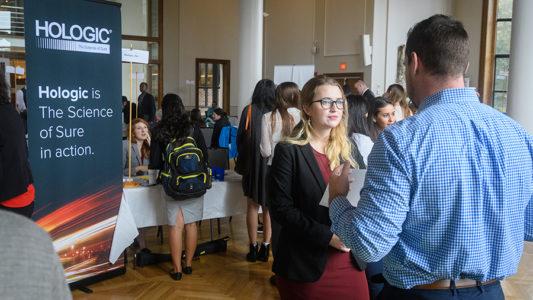 career fairs girl talking to employer