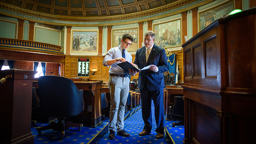 intern going over documents with state representative