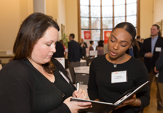 woman looking over resume with stude