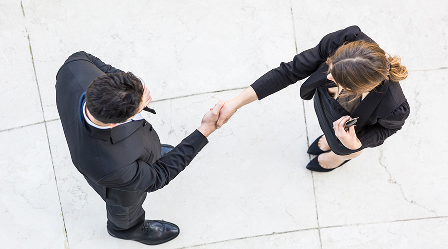 female and male shaking hands