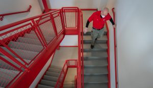 stairs with facilities employee