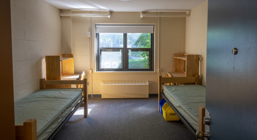 Bullock dorm room with double windows and double beds