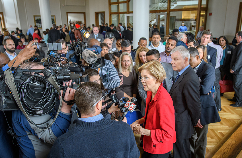 Elizabeth Warren surrounded by media