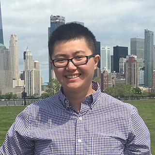 Wu standing in city atmosphere