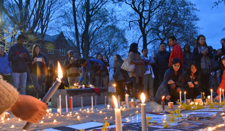 Clark students holding candles